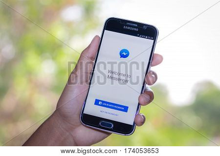 Chiang Mai,Thailand - March 2, 2017: Smartphone Samsung Galaxy S6 open apps facebook messenger application on the screen on the desk.