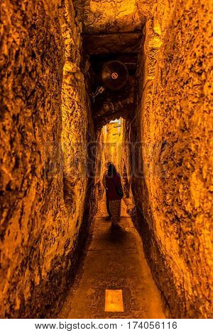 JERUSALEM, ISRAEL - MAY 23, 2016: Narrow passage in Western Wall tunnel, foot of the western side of the Temple Mount in old city.