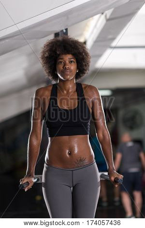 african american athlete woman workout out arms on dips horizontal parallel bars Exercise training triceps and biceps doing push ups