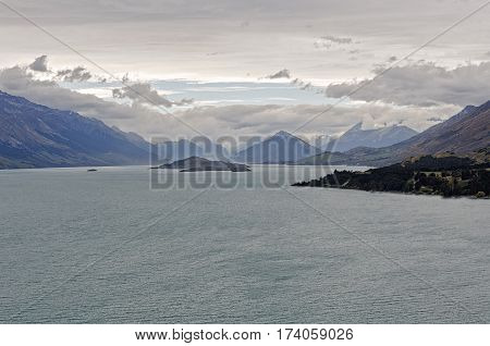 Heavy clouds above Lake Wakatipu near Queenstown on the South Island of New Zealand