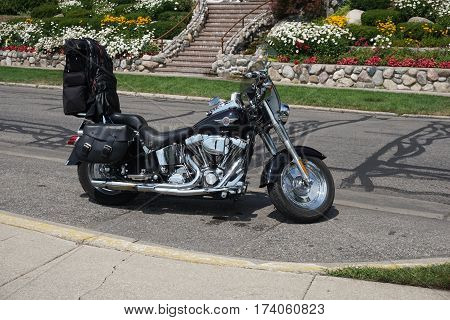HARBOR SPRINGS, MICHIGAN / UNITED STATES - AUGUST 4, 2016: A Harley Davidson motorcycle is parked on Bay Street in downtown Harbor Springs.