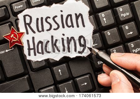 Russian hacking, inscription on torn  white paper  sheet. Russia hacking concept