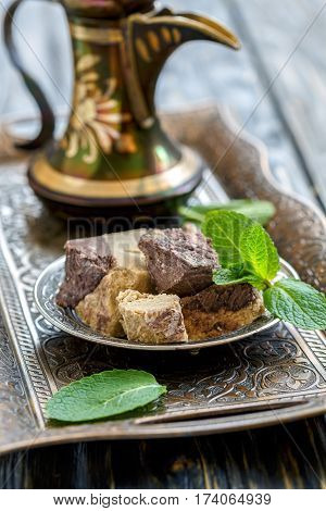 Plate With Tahini Halva With Chocolate And Jug.