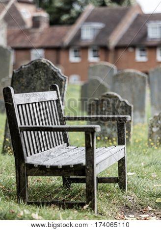 Empty seat in a church graveyard, sadness metaphor