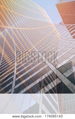 Looking up a curved skyscraper office block