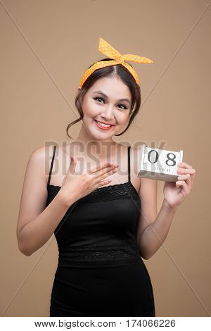 Asian beautiful woman holding March 8th Calendar Women Day