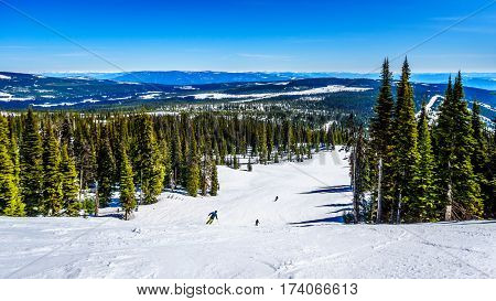 Spring Skiing on the Slopes of the Ski Hills at the Alpine Village of Sun Peaks in the Shuswap Highlands of central British Columbia, Canada