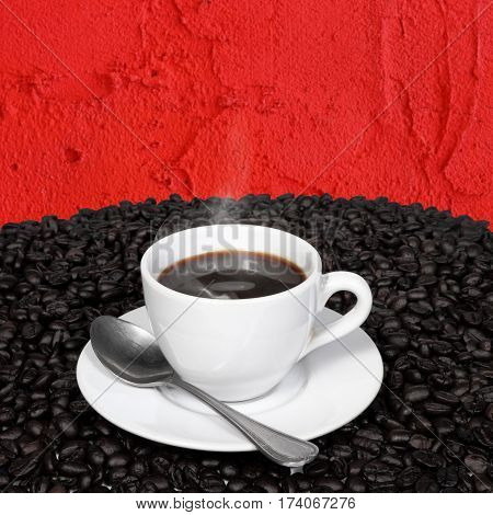 Hot coffee and coffee beans with smoke in a white cup with spoon on red cement wall background.