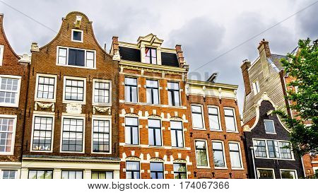 Bell Gables and Neck Gable of Historic Houses along the canals of in Amsterdam, the Netherlands