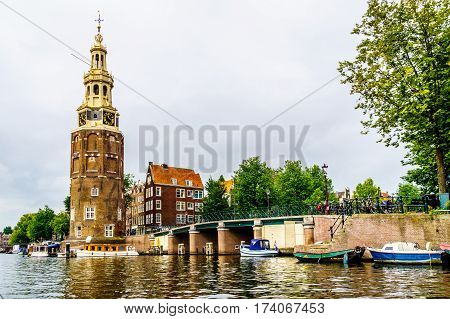 Montelbaanstoren and Historic Houses from the Middle Ages along the canals in Amsterdam, The Netherlands