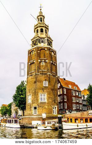 Montelbaanstoren and Historic Middle Age Houses along the canals in Amsterdam, The Netherlands