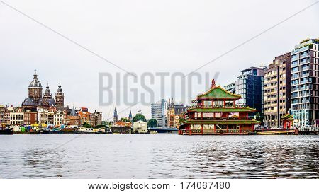 View of the buildings and boats in and around the harbor of Amsterdam, the Netherlands