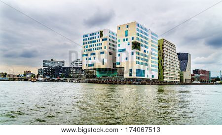 Public Building of the Palace of Justice viewed along the Harbor named Het IJ in Amsterdam, the Netherlands