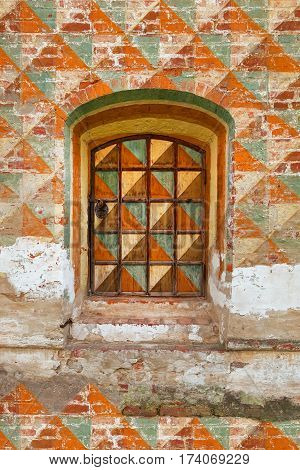 A fragment of the old wall of the house with a window. Texture background architecture