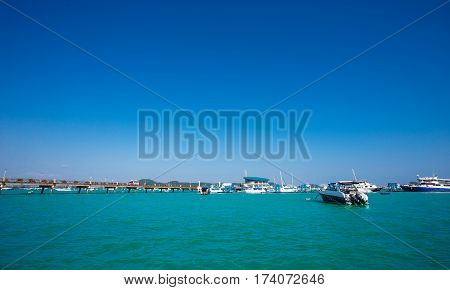 Landscape Of Cha-long Pier With Speed Boat In Brighter Day