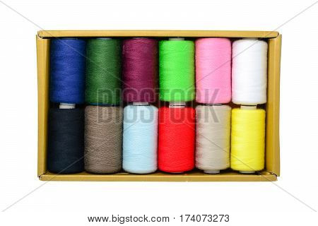 Spools of thread in box isolated on white with clipping path