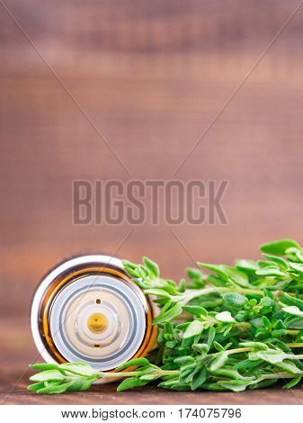 Fresh raw green herbs leaf - mint, rosemary, thyme - over gray stone background. Flat lay or top view