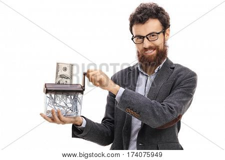 Man destroying a dollar banknote in a paper shredder isolated on white background