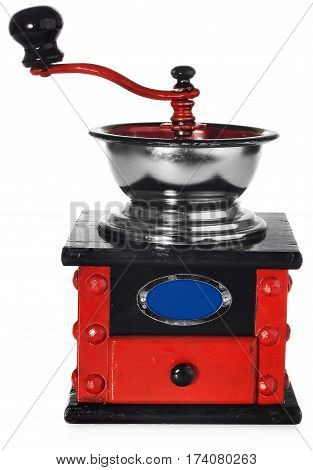 Old antique wooden coffee grinder. Coffee grinder hand-painted in black red and blue. The device isolated on a white background with light shadow and reflection.