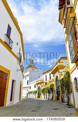 small Streets with white houses in seville, spain