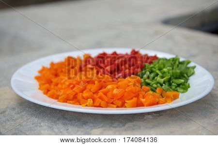 Pepper Green ,yellow and red pepper in a plate, Maltese food, maltese peppers. Colored sweet peppers. colorful paprika, natural background. Paprika slices