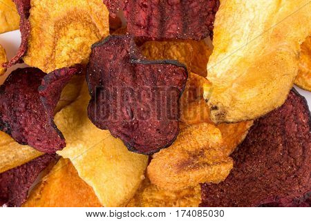 Crunchy colorful organic vegetable chips. Mixed salted vegetable crisps. Healthy snack. Food background.