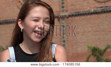 A Young Teen Redhead Pretty Girl Winking