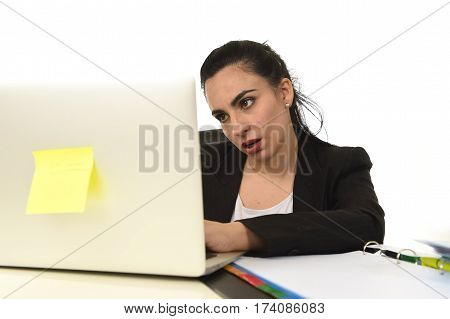 young attractive woman in business suit working tired and bored in office computer desk looking sad and depressed isolated on white background