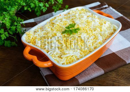 Light spring salad with boiled vegetables eggs and sardines in oil. Slavonic traditional dish of