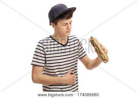 Teenager having a sandwich and experiencing stomach pain isolated on white background