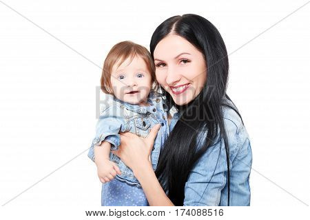 Portrait of a happy mother with her cute daughter at the hands, isolated on white background
