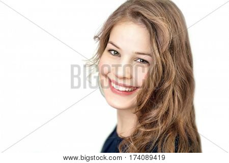 Happy young girl with long hair full smiling at camera