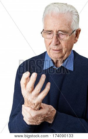 Studio Shot Of Senior Man Suffering With Arthritis