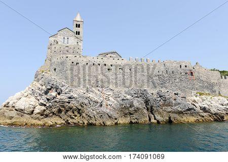 Portovenere Italy - 7 July 2015: Old church on a rocky coastal outcrop at Portovenere Italy
