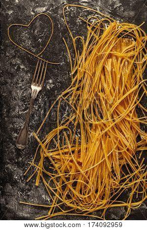 Raw fresh homemade pasta spaghetti top view.