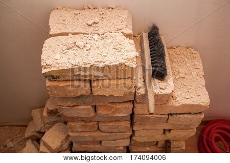 Renovation Apartment Complex Bricks, Prepared For Disposal In The Trash, The Wall Of The Buffed