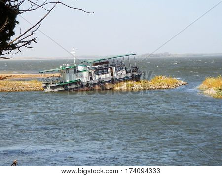 A small ship stranded off the coast of the river Volga