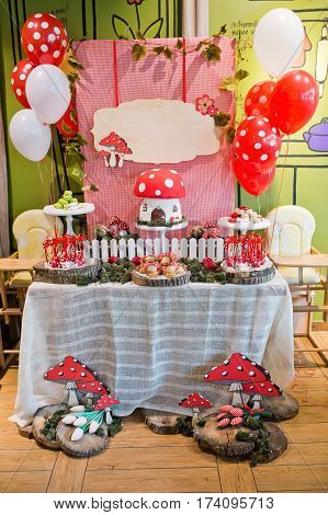 beautiful buffet tables with a sweet and decorations
