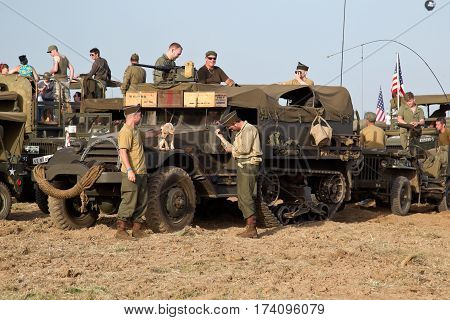 WESTERNHANGER, UK - JULY 18: Re-enactors prepare to go out onto the public highway in convoy as part of the after hours entertainment at the War & Peace show on July 18, 2014 in Westernhanger