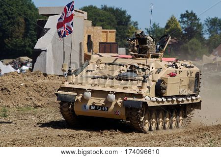 WESTERNHANGER, UK - JULY 16: An ex British army CRV armoured vehicle is driven around the show arena at speed for the public to watch at the War & Peace show on July 16, 2014 in Westernhanger