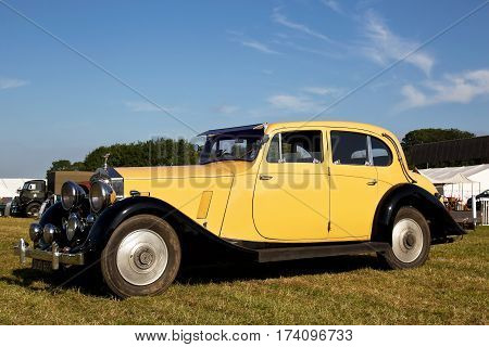 WESTERNHANGER, UK - JULY 17: A vintage Rolls Royce motorcar stands on display for the public to view at the War & Peace show on July 17, 2014 in Westernhanger