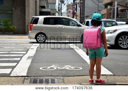 Children Japanese Girl Waiting Cross Over Road At Crosswalk Traffic Road After Finished Study Class