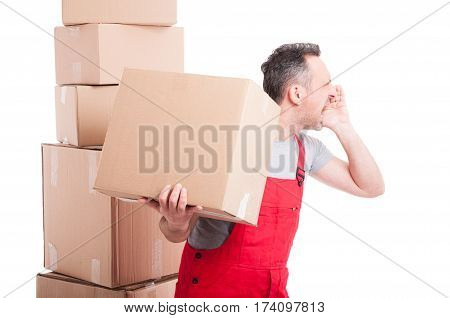 Side View Of Mover Guy Holding Box And Screaming