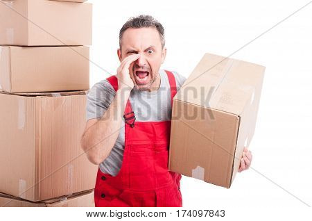 Portrait Of Mover Man Holding Box And Screaming Loud