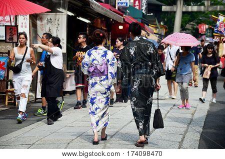 Japanese People Wear Traditional Japanese Clothing (kimono And Yukatas) And Travelers People Walking