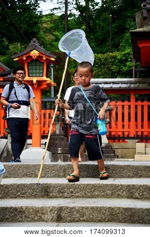 Japanese Children People Holding Insect Net Or Swing Fishing Nets And Running Go To Garden