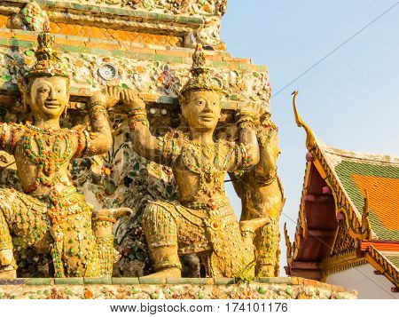 Stone statues in the ancient Wat Arun Temple. Bangkok, Thailand