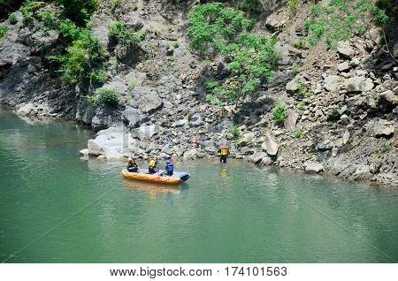 Japanese People And Traveler Foreigner Tour Rafting By Inflatable Rubber Boat At Hozugawa River Betw