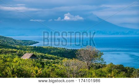 Beautifull evening view to St. Agung Vulcano on Bali from Nusa Penida Island. Partly Covered by Clouds. Indonesia.