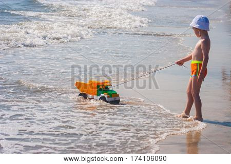 CONSTANTA ROMANIA - AUGUST 21 2010. Baby boy playing with toys on the sea